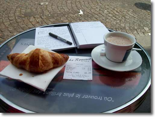 What to eat in Paris? Croissants and coffee at the foot of the Sacre Coeur church in Montmartre.