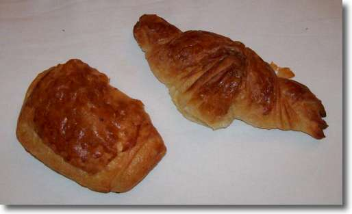What to eat in Paris? Two croissants - a butter croissant and a pain au chocolat which is a chocolate croissant.