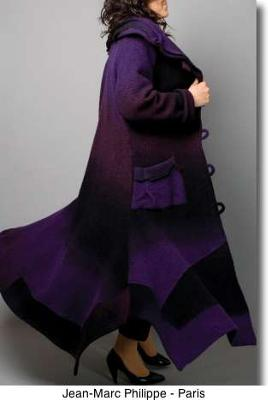 A  plus size woman will feel beautiful wearing this French coat, available in Paris
